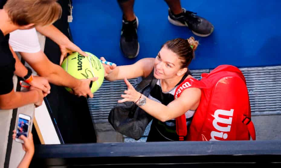 Simona Halep signs autographs after defeating Venus Williams in straight sets.