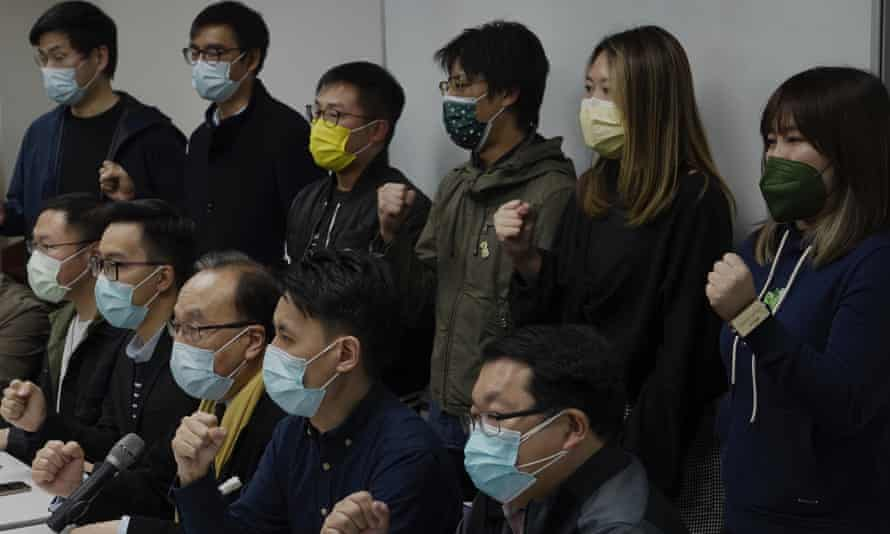 Pro-democratic party members hold a press conference in response to mass arrests in Hong Kong.