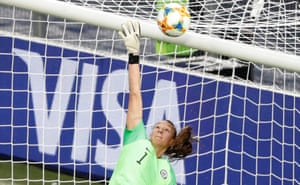 Chile's keeper Christiane Endler pushes the ball over the bar.