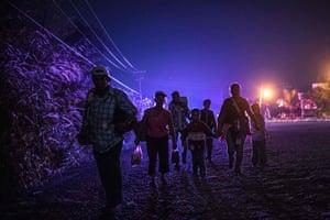 Honduran migrants taking part in a caravan heading to the US, walk in Huixtla, Chiapas state, Mexico, on October 24, 2018.