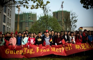 """Students with a banner await the arrival of German Chancellor Merkel at the German University in Hefei<br>Students with a banner that reads """"Good day, Mrs Merkel!"""" await the arrival of German Chancellor Angela Merkel at the German University in Hefei October 30, 2015. REUTERS/ JOHANNES EISELE/Pool"""