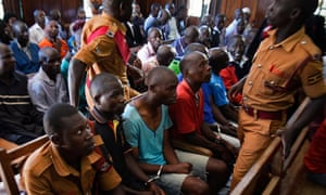 Forty-seven men being tried for sexual violence against women and girls attend a special session at the Kampala High Court in Uganda