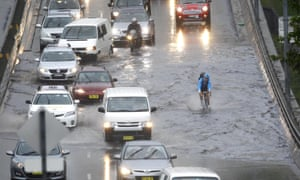 A cyclist powers his way through a flooded Syd Einfeld Drive, at Bondi Junction on Wednesday morning.