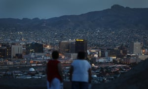 People look out at the lights of El Paso and Ciudad Juárez, Mexico.