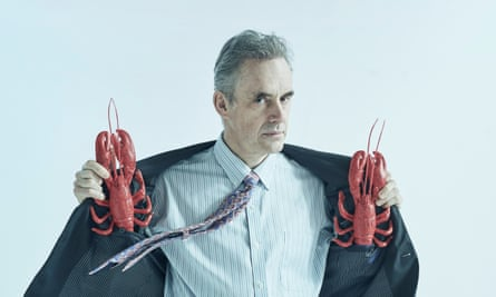 Jordan Peterson holding two lobsters