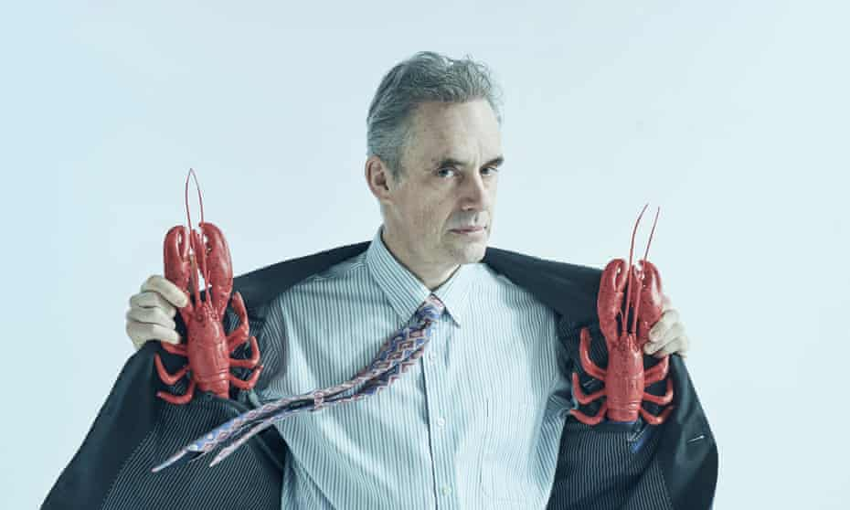 Jordan Peterson holding two lobsters