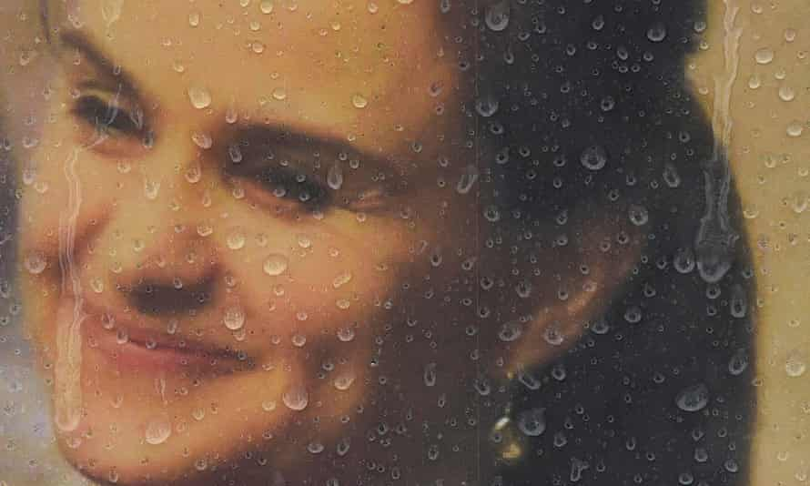 Raindrops land on a framed photograph of murdered MP Jo Cox at Parliament Square in London.