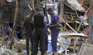 Security forces in the remains of houses destroyed after a suicide bomb attack in Mogadishu two weeks ago.  Five people were killed in an explosion near a police academy.
