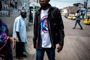 A man wears a T-shirt bearing an image of Joseph Kabila's preferred successor, Emmanuel Ramazani Shadary