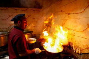 A worker cooks a meal with truffles at a restaurant
