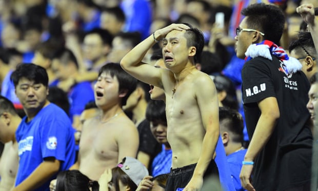 Shanghai Shenhua fans during their dramatic 8-7 penalty shoot-out victory over local rivals Shanghai SIPG in last month's Chinese Cup quarter-finals.