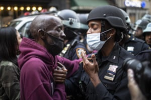Protester and police officer shake hands