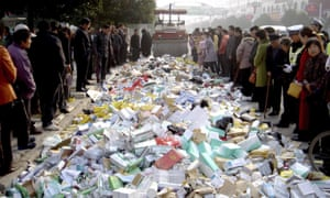A steamroller destroys fake medicines in Suqian, east China