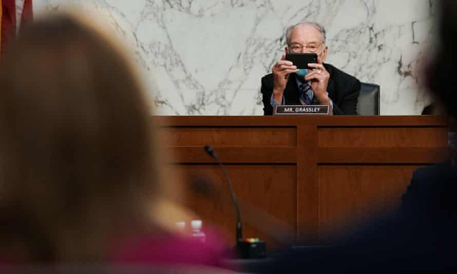 Republican senator Chuck Grassley takes a picture during the hearing on Monday.
