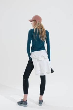 white zip hoodie, blue long sleeved crew neck top, black leggings Lulu Lemon, grey and black trainers Nike, water bottle Sweaty Betty, pale pink cap H&M
