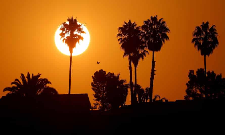 The sun rises over a neighborhood in Encinitas, California, amid a heatwave last year.