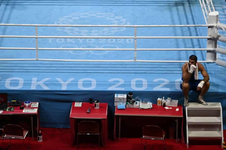 Mourad Aliev waits outside the ring after losing