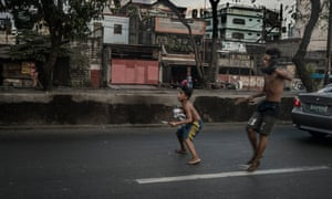 Boys, armed with a knife and a rusty machete, emerge from a slum in Tondo, Manila, to pursue a rival across a highway, through rush-hour traffic to attack him