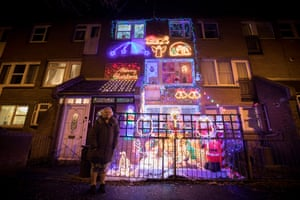 Debbie and Tony Righelato, who have been putting Christmas lights up outside their home in Islington, north London, for 20 years
