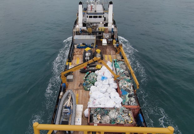 The M/V Imua, 180ft supply vessel, as it steams into port in Honolulu carrying 94,472lb of marine debris on deck. Photograph: David Golden