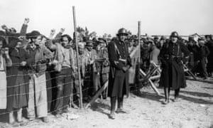 Spanish refugees, mainly republicans and members of the international brigades, guarded by French troops at a camp on Argeles beach in 1939.