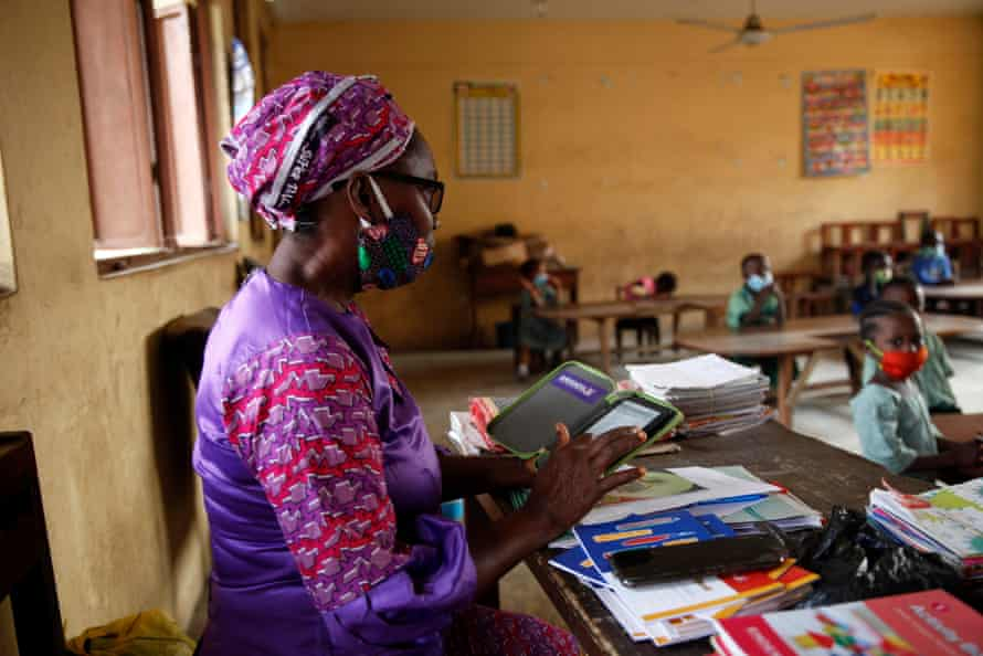 Teacher Grace Olowoje calls registration during an open house at Dairy Farm Primary School in the Agege district of Lagos, Nigeria on January 22, 2021.