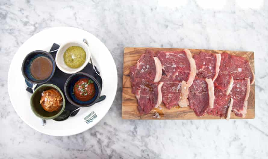Fifty-day aged beef picanha with accompanying sauces, at Parillan, Kings Cross, London.