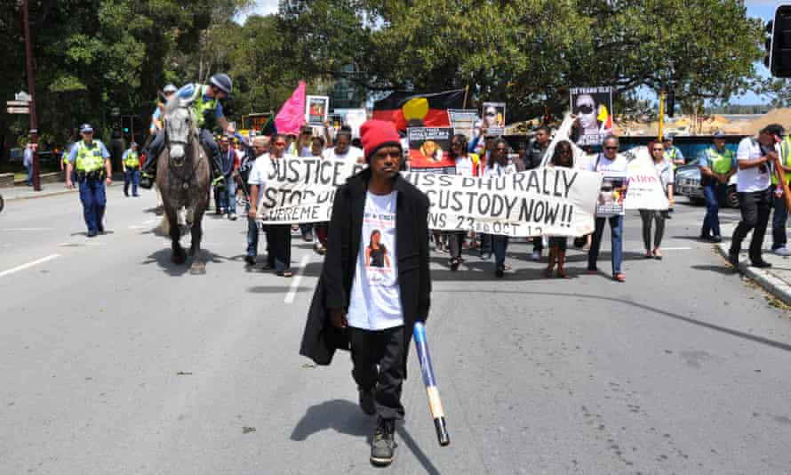 Protesters march on the steps of WA's parliament in October 2014 rallying against deaths in custody and calling for justice for Ms Dhu.
