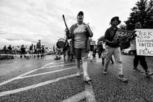 Lisa O'Reilly leads a march down York Road carrying incense and sage