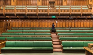 Cleaner dusting in the Commons Chamber, Palace of Westminster