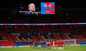 England's Harry Kane is shown on the big screen as the players line up.