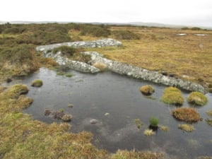 Water pools around remnants of hollowed-out moorstone, Bodwin Moor