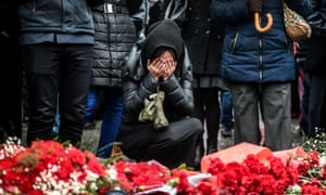 Mourners at the site of explosions near a football stadium in Istanbul that killed 44 people on Tuesday.