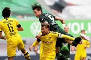 Wolfsburg's Wout Weghorst gets above Borussia Dortmund's Lukasz Piszczek to win a header.
