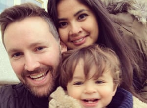 Nerisa Ahmed and her husband, Asher Garnett, with their son
