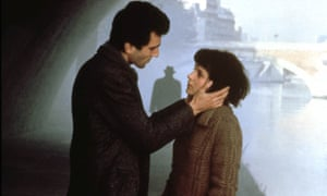Daniel Day-Lewis holding Juliette Binoche's face as they look intently into each other's eyes