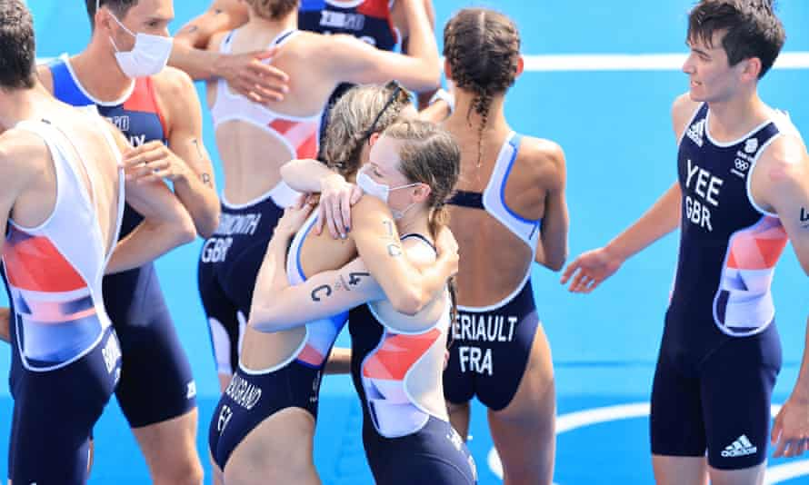 Athletes congratulate each other at the end of the first ever Olympic triathlon mixed relay.