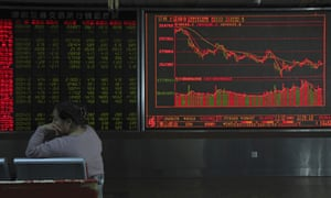 A Chinese woman rests near boards displaying stock market prices in Beijing, China, Thursday.