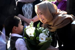 NZEALAND-AUSTRALIA-ATTACKS-MOSQUENew Zealand's Prime Minister Jacinda Ardern (R) receives a bouquet of flowers from a boy as she arrives at the Al Noor mosque to unveil a plaque in memory of the victims killed in the 2019 twin mosque shootings, in Christchurch on September 24, 2020. (Photo by SANKA VIDANAGAMA / AFP) (Photo by SANKA VIDANAGAMA/AFP via Getty Images)