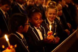 Leeds, England: School pupils take part in a Christingle service