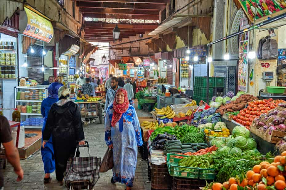 market stalls with food in the narrow alleys in old town (medina) of Fez, Morocco