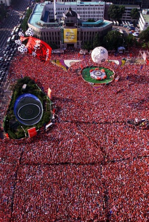 The streets of Seoul were turned red also as tens of thousands of fans watched the match on big screens.