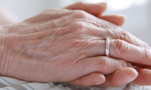 A mature woman's hands clasped