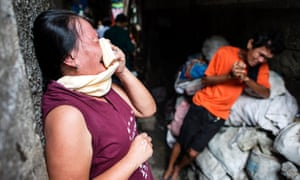 The grieving parents of a suspected drug user killed by the police in Manila, Philippines. More than 3000 people have died in a bloody three-months-old war on crime.