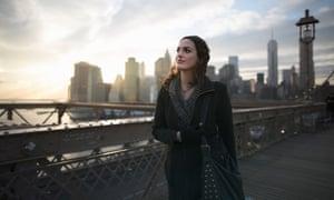 Young woman strolling on Brooklyn bridge