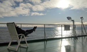 One of only two fellow passengers enjoying a sunny afternoon on board the cargo ship.