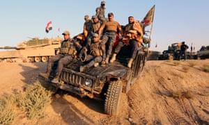 Iraqi forces enter Kirkuk on Monday.