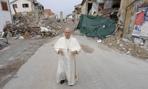 Pope Francis prays in front of quake ruins in Amatrice