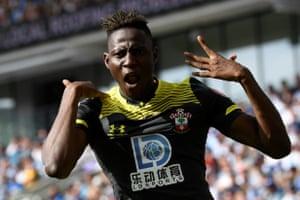 Southampton's Moussa Djenepo celebrates scoring their first goal in their 2-0 win over Brighton at the AMEX Community Stadium.