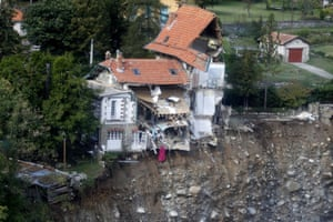 A badly damaged house where a landslide has occurred